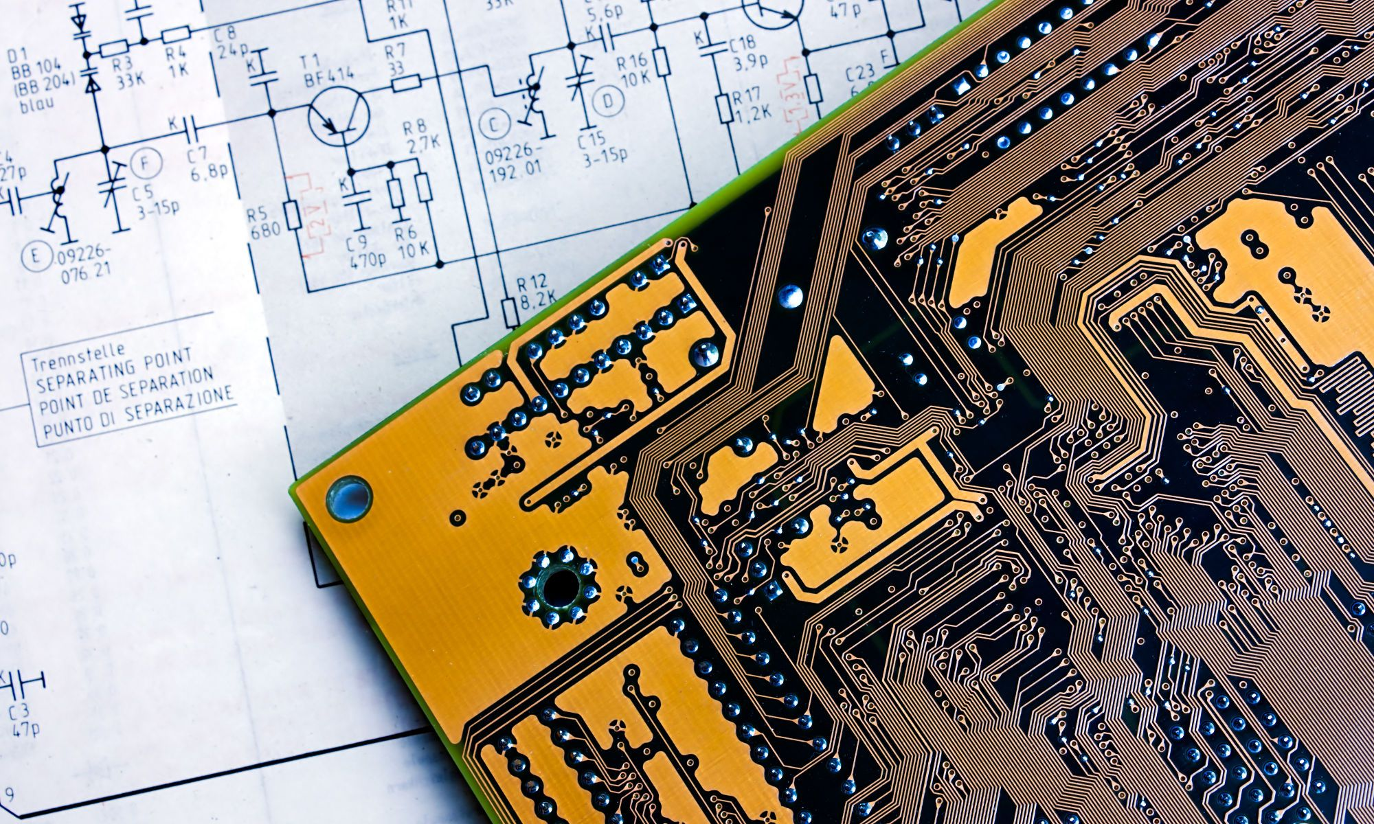 photo of schematic and bare PCB